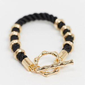 ASOS DESIGN - Svart och guldigt armband med T-spänne, rep och bambu