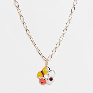 ASOS DESIGN - Guldfärgat halsband med bevarat blomsmycke